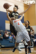 Terra Elison #32 of the The Colony blocks the shot of Frisco Wakeland guard Mariah Fluellen #4 at Little Elm High School on Friday, February 8, 2013 in Little Elm, Texas. (Cooper Neill/The Dallas Morning News)