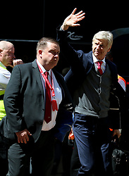 Arsenal manager Arsene Wenger (right) arrives at the stadium before the match begins