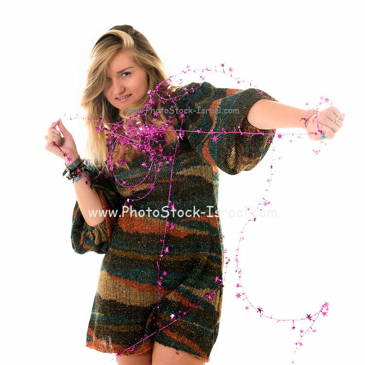 Young blond woman entangled in wire On white Background