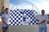 two Spurs fans hold up their Spurs flag outside Wembley Stadium before k/o. UEFA Champions league match, group E, Tottenham Hotspur v AS Monaco at Wembley Stadium in London on Wednesday 14th September 2016.<br /> pic by John Patrick Fletcher, Andrew Orchard sports photography.
