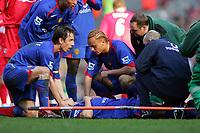 Gary Neville and Wes Brown comfort the injured Alan Smith as he lies in agony after Dislocating his Left Ankle<br />Manchester United 2005/06<br />Liverpool V Manchester United 18/02/06<br />The F/A Cup 5th Round<br />Photo Robin Parker Fotosports International