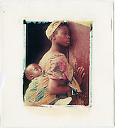 Mother and child waiting to enter a health clinic.<br /> Image size 4x5, Matted 12x10 Edition of 25 <br /> Archival Pigment Print