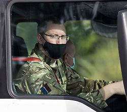 © Licensed to London News Pictures. 05/10/2021. Hemel Hempstead, UK. Military personnel seen at the wheel of a fuel tanker at Buncefield oil depot in Hemel Hempstead, Hertfordshire. Military personnel have started helping with driver shortages following more than a week of long queues and closures at petrol stations. Photo credit: Ben Cawthra/LNP