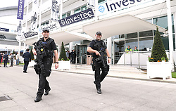 Armed police during Ladies Day of the 2019 Invested Derby Festival at Epsom Racecourse, Epsom.