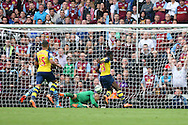 Danny Welbeck of Arsenal scores his side's second goal. Barclays Premier league match, Aston Villa v Arsenal at Villa Park in Birmingham on Saturday 20th Sept 2014<br /> pic by Mark Hawkins, Andrew Orchard sports photography.