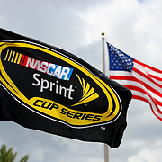 Race flags blow in the wind prior to the beginning of the 56th Annual NASCAR Coke Zero400 race at Daytona International Speedway on Saturday, July 5, 2014 in Daytona Beach, Florida.  (AP Photo/Alex Menendez)