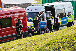 London, UK. 19th April, 2019. Police and specialist rescue vehicles alongside the main motorway approach to Heathrow airport. A large policing operation was put in place in and around the airport in preparation for expected protests by climate change activists from Extinction Rebellion. Only a very small symbolic protest by teenage activists from Extinction Rebellion Youth took place, dispersed by police officers under threat of arrest.