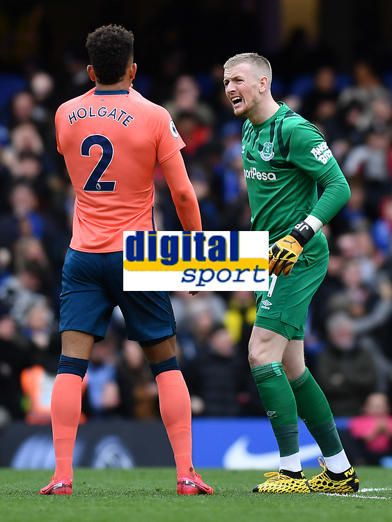 Football - 2019 / 2020 Premier League - Chelsea vs. Everton<br /> <br /> Everton's Jordan Pickford in discussion with Mason Holgate as Chelsea's Mason Mount scores the opening goal, at Stamford Bridge.<br /> <br /> COLORSPORT/ASHLEY WESTERN