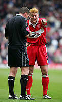 Photo. Andrew Unwin, Digitalsport<br /> Middlesbrough v Arsenal, Barclays Premiership, Riverside Stadium, Middlesbrough 09/04/2005.<br /> Middlesbrough's Franck Queudrue (R) pleads with the referee, Mr P Down (L), as he is booked for a body-check on Arsenal's Jose Reyes.