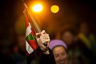 """The baton on the 20th Korrika. Tutera (Basque Country). April 1, 2017. The """"Korrika"""" is a relay course, with a wooden baton that passes from hand to hand without interruption, organised every two years in a bid to promote the basque language. The Korrika runs over 11 days and 10 nights, crossing many Basque villages and cities. This year was the 20th edition and run more than 2500 Kilometres. Some people consider it an honour to carry the baton with the symbol of the Basques, """"buying"""" kilometres to support Basque language teaching. (Gari Garaialde / Bostok Photo)"""