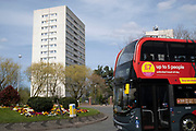 Local atmosphere due to Coronavirus lockdown is felt on a street by street level as streets remain deserted as a bus passes near the tower blocks of flats of the Civic Centre Estate as people observe the stay at home advice from the government on 7th April 2020 in Birmingham, England, United Kingdom. Coronavirus or Covid-19 is a new respiratory illness that has not previously been seen in humans. While much or Europe has been placed into lockdown, the UK government has announced more stringent rules as part of their long term strategy, and in particular social distancing.