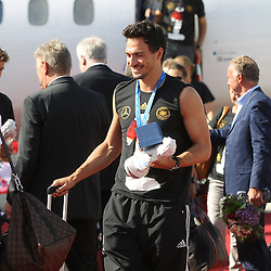15.07.2014, Flughafen, Muenchen, GER, FIFA WM, Empfang der Weltmeister in Deutschland, Finale, im Bild Mats Hummels #5 (Deutschland) kommt aus der Maschiene // during Celebration of Team Germany for Champion of the FIFA Worldcup Brazil 2014 at the Flughafen in Muenchen, Germany on 2014/07/15. EXPA Pictures © 2014, PhotoCredit: EXPA/ Eibner-Pressefoto/ Kolbert  *****ATTENTION - OUT of GER*****