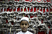 Omani young boy<br /> <br /> The Sultanate of Oman is a country in Southwest Asia. It borders the United Arab Emirates in the northwest, Saudi Arabia in the west, and Yemen in the southwest.<br /> The oil discovery, in the 60's, started to transform this asleep country. Today, Oman is  torn by modern roads, industrialized and rich ( Omanization ). The tradition still dominates life of the 2,5 million inhabitants: strong religion ( muslim ), traces of tribal loyalties and a very characteristic culture.