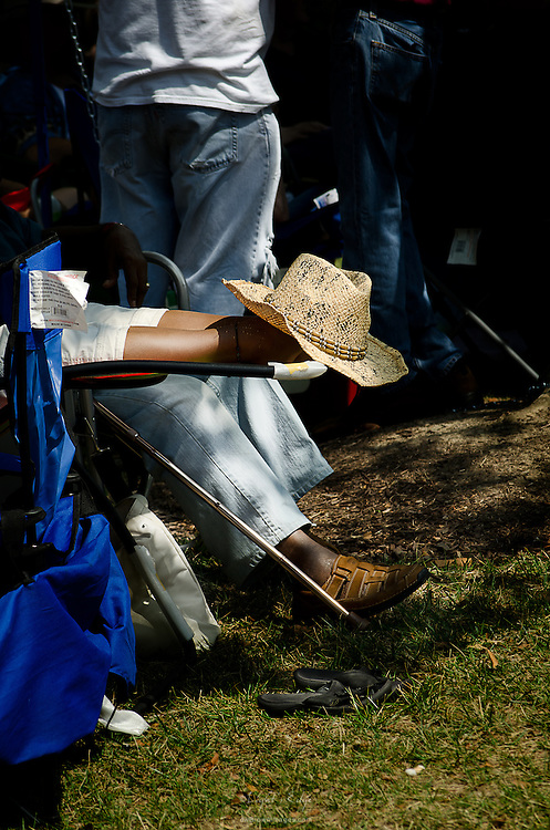 An audience member keeps their feet cool during the hot blues in the air at the Riverfront Blues Festival in Wilmington, DE.