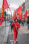 Members of the Communist Party of Great Britain show solidarity - the May Day March from Clerkenwell Green ending with a rally in Trafalgar Square - against cuts and anti 'Trade Union laws. It was supported by several trade unions including UNITE, PCS, ASLEF, RMT, TSSA, NUT, FBU, GMB and UNISON as well as the Peoples Assembly, Pensioners' organisations and organisations representing migrant workers & communities.