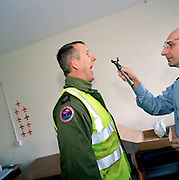 Member of the 'Red Arrows', Britain's Royal Air Force aerobatic team has ear, nose, throat medical check by RAF doctor.