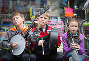 **NO REPRO FEE** Charlie and Cillian Flynn and Gracie Conachy from Cavan playing on Abbey street at the Fleadh in Ennis on Monday. Photograph by Eamon Ward