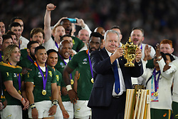 Chairman of World Rugby Sir Bill Beaumont lifts the William Webb Ellis Trophy before passing it to the Crown Prince of Japan after the 2019 Rugby World Cup final match at Yokohama Stadium.