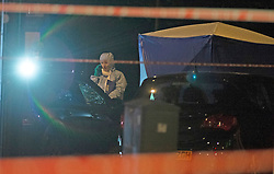©Licensed to London News Pictures 08/09/2019.<br /> Sydenham ,UK.A forensic officer looking at a car with a smashed windscreen. Man in his twenties is dead after a shooting in Sydenham, South East London. A police cordon is in place as forensic officers work at the scene tonight. Photo credit: Grant Falvey/LNP