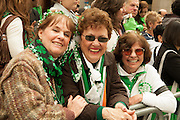 Three women enjoy each others company at the parade.