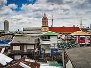 14 SEPTEMBER 2016 - BANGKOK, THAILAND: The spire for Santa Cruz Catholic church towers over the Kudijeen neighborhood in Bangkok. Santa Cruz is one of the first Catholic churches in Bangkok. It was established by Portuguese mercenaries serving King Taksin the Great in 1770.      PHOTO BY JACK KURTZ