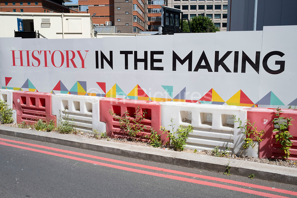 History in the making hoarding up for the redevelopment of Paradise as the Coronavirus lockdown continues, the city centre is still very quiet while more traffic and people are returning, and with restrictions due to be relaxed further in the coming days, the quiet city may be coming to an end as businesses are set to start to reopen soon on 27th May 2020 in Birmingham, England, United Kingdom. Paradise, formerly named Paradise Circus, is the name given to an area of approximately 7 hectares in Birmingham city centre between Chamberlain and Centenary Squares. The area has been part of the civic centre of Birmingham since the 19th century. From 2015 Argent Group will redevelop the area into new mixed use buildings and public squares. Coronavirus or Covid-19 is a respiratory illness that has not previously been seen in humans. While much or Europe has been placed into lockdown, the UK government has put in place more stringent rules as part of their long term strategy, and in particular social distancing.