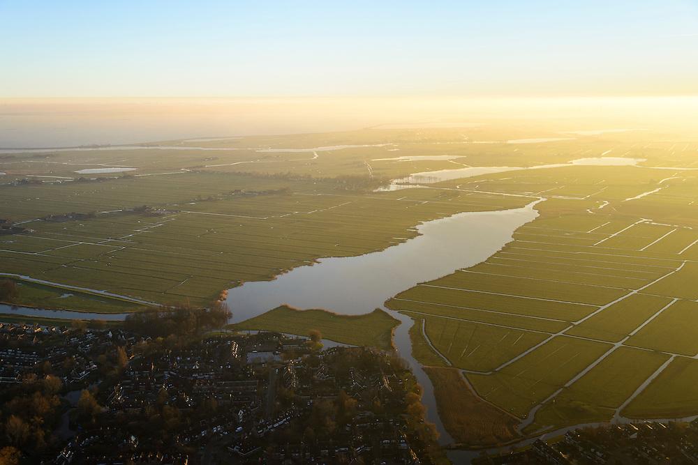 Nederland, Noord-Holland, Monnickendam, 11-12-2013; Waterland ter hoogte van Monnickendam. Ooster Ee bij ondergaande zon.<br /> Waterland, north of Amsterdam, with winter sunset<br /> luchtfoto (toeslag op standaard tarieven);<br /> aerial photo (additional fee required);<br /> copyright foto/photo Siebe Swart.