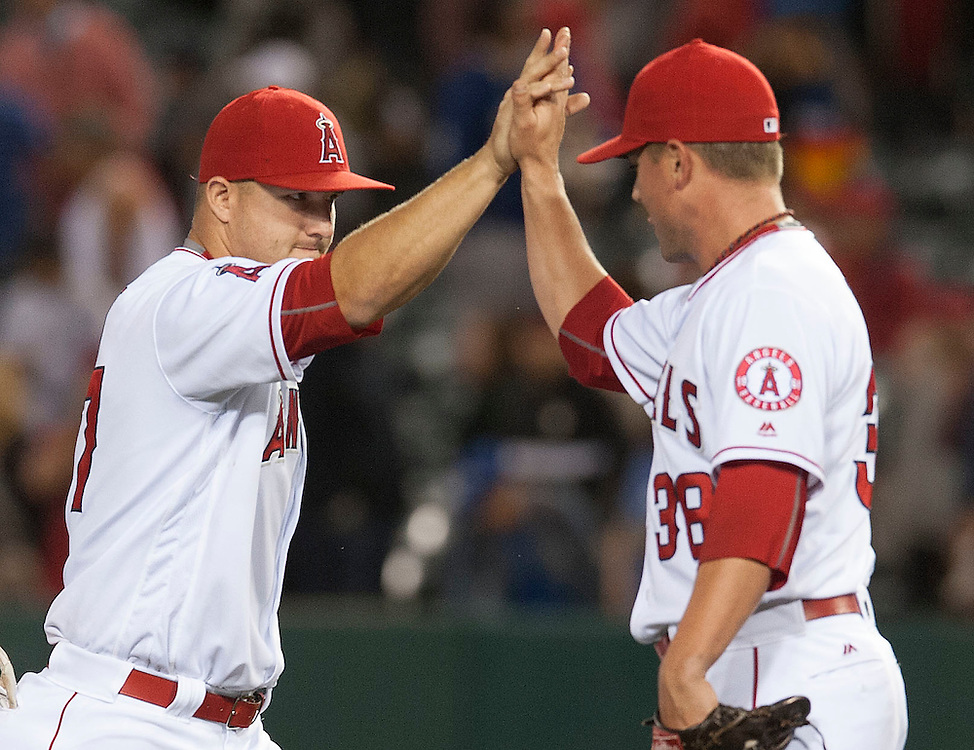 The Angels' Mike Trout celebrates with Joe Smith after the Angels' 4-2 victory over the Kansas City Royals Wednesday night at Angel Stadium.<br /> <br /> ///ADDITIONAL INFO:   <br /> <br /> angels.0428.kjs  ---  Photo by KEVIN SULLIVAN / Orange County Register  --  4/27/16<br /> <br /> The Los Angeles Angels take on the Kansas City Royals Wednesday at Angel Stadium.<br /> <br /> <br />  4/27/16