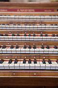 close up of an wooden organ keyboard