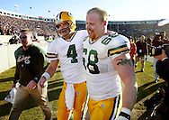 Green Bay's Brett Favre and Mike Wahle walk off the field after beating the Chicago Bears Sunday.  The Green Bay Packers Traveled to Chicago to play the Chicago Bears Sunday, November 11, 2001 at Soldier Field in Chicago. WSJ/Steve Apps.
