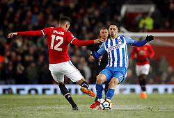 Manchester United's Chris Smalling (left) and Brighton & Hove Albion's Beram Kayal battle for the ball during the Emirates FA Cup, quarter final match at Old Trafford, Manchester.