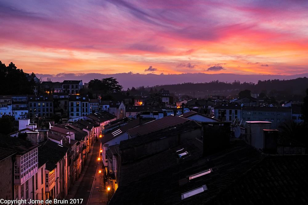 The old street of Santiago de Compostela at sunset.