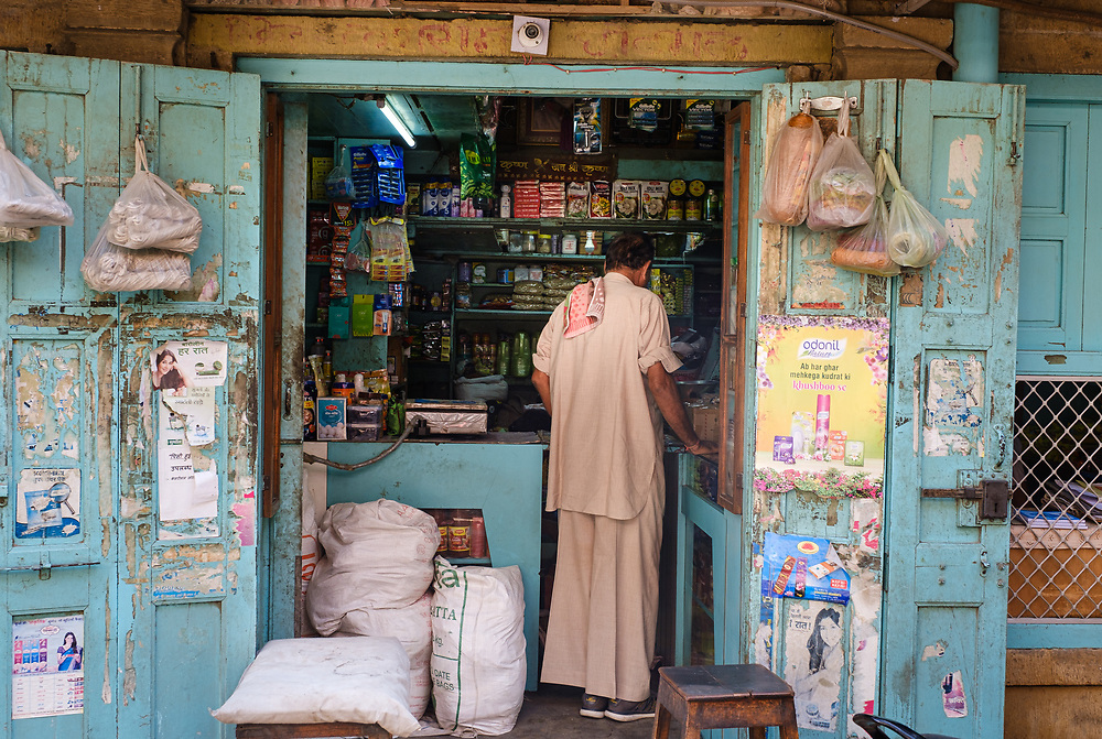 """JAISALMER, INDIA - CIRCA NOVEMBER 2018: Storefront on the streets of Jaisalmer is also called """"The Golden City, and it is located in Rajasthan. . The town stands on a ridge of yellowish sandstone, and is crowned by the ancient Jaisalmer Fort."""