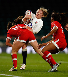 England's Lydia Thompson and Canada's Julianne Zussman during the Old Mutual Wealth Series match at Twickenham Stadium, London.