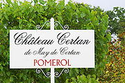 A white sign in the vineyards saying Chateau Certan de May de Certan Pomerol Bordeaux Gironde Aquitaine France