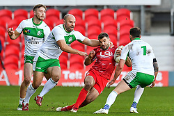 11th November 2018 , Racecourse Ground,  Wrexham, Wales ;  Rugby League World Cup Qualifier,Wales v Ireland ; Elliot Kear of Wales is tackled by Liam Finn of Ireland <br /> <br /> Credit:   Craig Thomas/Replay Images