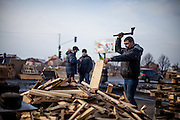"Activist ""Bosch"" preparing fire wood with an axe at the barricades blocking a building supplies store named ""Epicenter"" in the city of Lviv, Ukraine."