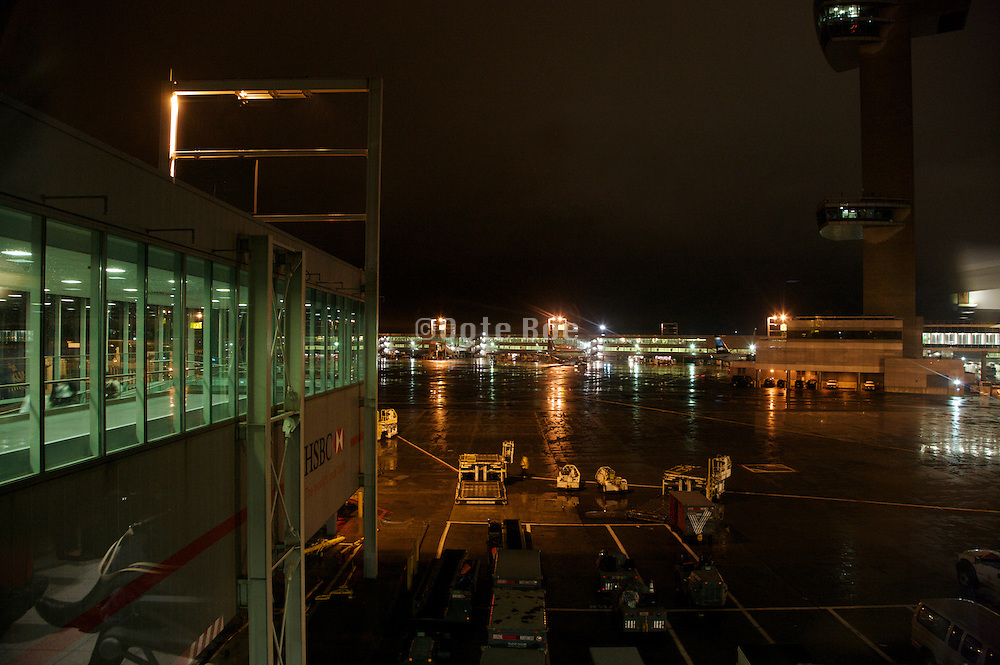 JFK airport boarding gate with air traffic control tower in the background