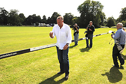 SIR IAN BOTHAM throwing the ball in to start the polo match at the IWC Laureus Polo Cup Day 2008 held at Ham Polo Club, Surrey on 22nd June 2008.<br />