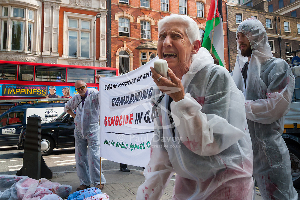 "London, August 4th 2014. A woman from British Jews Against Genocide protests against the Board of Deputies of British Jews' ongoing support for Israel's ""genocide"" in Gaza as the Israeli attacks continue."