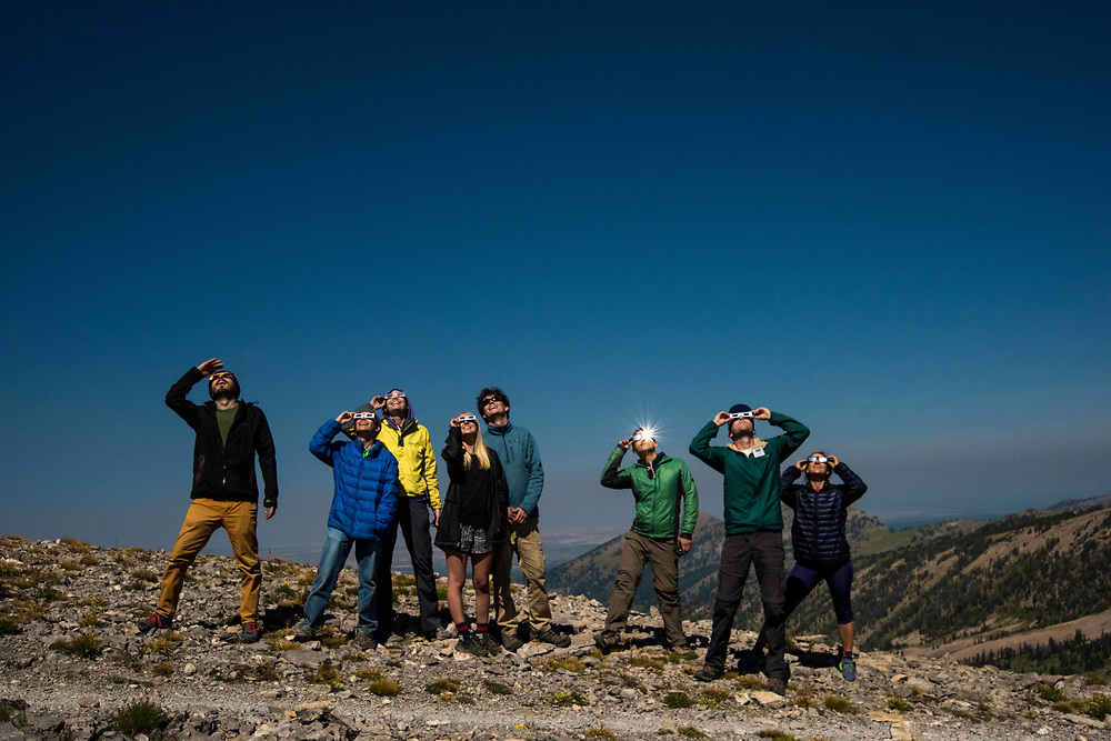 Explorers look at the Great American Eclipse during totality.