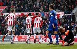 Stoke City's Eric Maxim Choupo-Moting (centre) celebrates scoring his side's first goal of the game with teammate Kurt Zouma