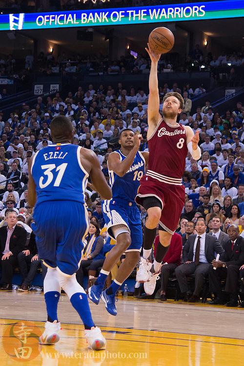 December 25, 2015; Oakland, CA, USA; Cleveland Cavaliers guard Matthew Dellavedova (8) shoots the basketball during the second quarter in a NBA basketball game on Christmas against the Golden State Warriors at Oracle Arena. The Warriors defeated the Cavaliers 89-83.