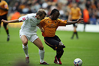 Photo: Rich Eaton.<br /> <br /> Wolverhampton Wanderers v Luton Town. Coca Cola Championship. 26/08/2006. Wolves goalscorer Jemal Johnson fends off the challenge of Leon Barnett of Luton