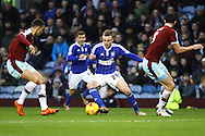 Freddie Sears of Ipswich Town (c) looks to go between the Burnley defenders. Skybet football league Championship match, Burnley v Ipswich Town at Turf Moor in Burnley, Lancs on Saturday 2nd January 2016.<br /> pic by Chris Stading, Andrew Orchard sports photography.
