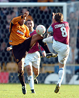 Photo. Matthew Lewis.<br /> Wolverhampton Wanderers v West Ham United. FA Cup 4th Round. 25/01/2004.<br /> <br /> West Hams' David Connolly and Wolves' Paul Ince challenge for the ball.