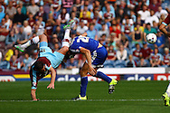 Lukas Jutkiewicz of Burnley takes a tumble over James Tarkowski of Brentford. Skybet football league championship match, Burnley  v Brentford at Turf Moor in Burnley, Lancs on Saturday 22nd August 2015.<br /> pic by Chris Stading, Andrew Orchard sports photography.