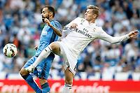 Real Madrid's Toni Kroos (r) and Getafe's Diego Castro during La Liga match. May 23,2015. (ALTERPHOTOS/Acero)