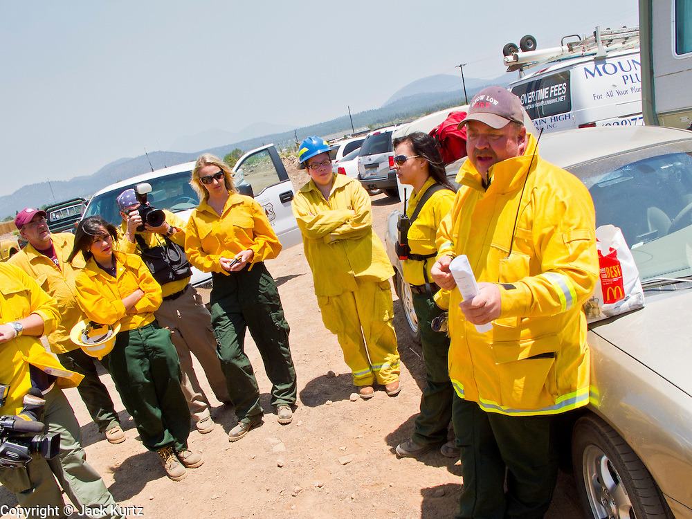 22 JUNE 2010 - FLAGSTAFF, AZ: Fire officials conduct a media briefing for reporters before taking them on the line at the Schultz Fire burning north of Flagstaff, AZ. The fire has consumed more than 12,000 acres of forest land and burned within a few feet of homes in some neighborhoods in Flagstaff. PHOTO BY JACK KURTZ