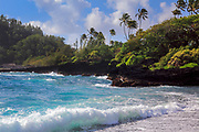 "Waves at Hana Bay on the northeast coast of Maui, Hawaii, in the town of Hana<br /> .....<br /> The island of Maui is the second-largest of the Hawaiian Islands and is the 17th largest island in the United States. Maui is part of the State of Hawaii and is the largest of Maui County's four islands, bigger than Molokaʻi, Lānaʻi, and unpopulated Kahoʻolawe. Native Hawaiian tradition gives the origin of the island's name in the legend of Hawaiʻiloa, the navigator credited with discovery of the Hawaiian Islands. According to that legend, Hawaiʻiloa named the island of Maui after his son, who in turn was named for the demigod Māui. The earlier name of Maui was ʻIhikapalaumaewa. The Island of Maui is also called the ""Valley Isle"" for the large isthmus between its northwestern and southeastern volcanoes and the numerous large valleys carved into both mountains."